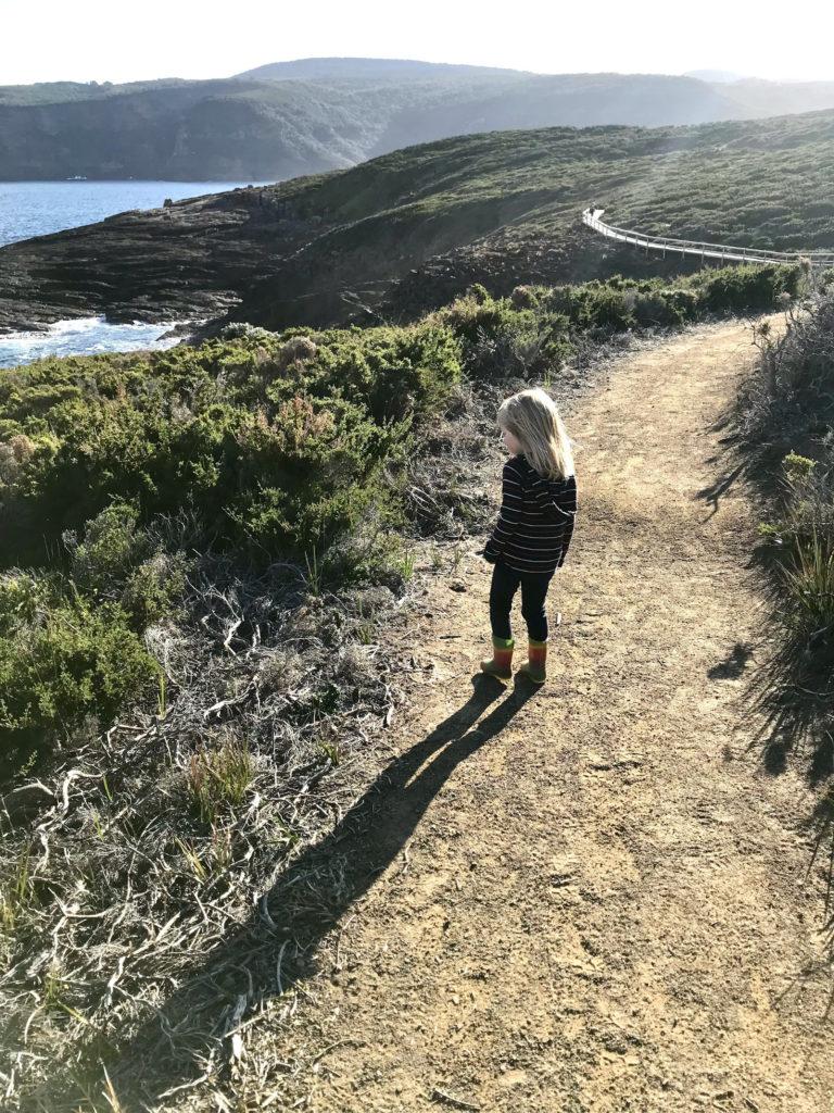 Young girl on a bushwalking track on Tasmania's East Coast