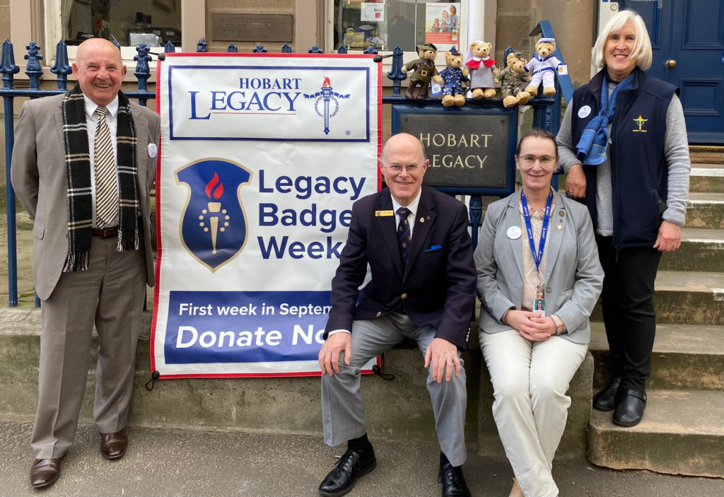 Four people with a sign for Legacy Badge Week from Hobart Legacy